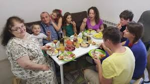 family enjoying thanksgiving meal at table on r3d stock