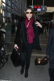 elizabeth hurley cuts an effortlessly stylish figure in large coat