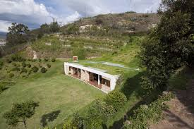 house built into a hill square meter ecuador and environment