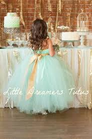 this flower dress in mint green with a gold sash is too cute