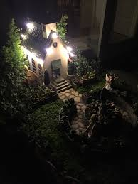 miniature fairy garden in awe as the christian village church is