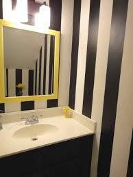 width of shower allows for doorless curbless masculine bathroom