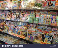news agents shelves showing books comics and magazines stock photo