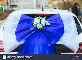 a black wedding car decorated with roses luxury wedding car stock