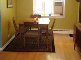 Best Rugs For Laminate Floors Rug Under Round Kitchen Dining Table Laminate Wood Flooring Beige
