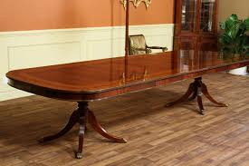large oval mahogany double pedestal dining room table with extra wide 12 foot dining table seats about 14 people with all three