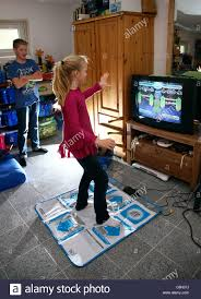 two kids 10 and boy 13 years old playing at home with a wii