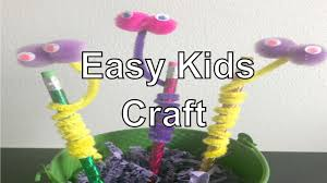 dollar store monster pencil topper with pom poms pipe cleaners