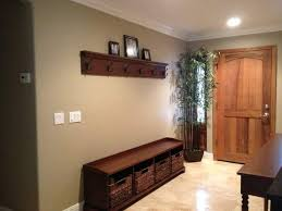 hand crafted entry bench and coat hook shelf by santini custom