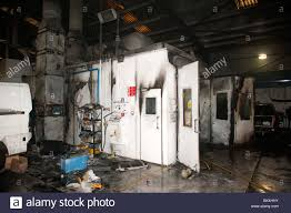 car spraying paint booth oven burnt out following fire stock photo
