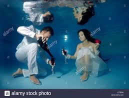 underwater wedding and groom underwater wedding in a pool stock photo royalty
