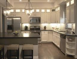 Mixed Kitchen Cabinets Distressed White Kitchen Cabinets Mixed Glass Chandeliers