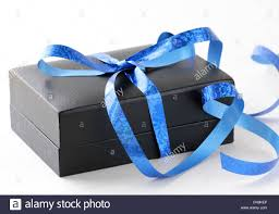 black and blue ribbon black gift box with a blue ribbon on a white background stock