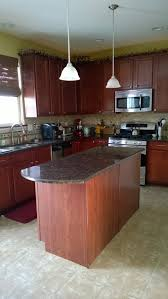 what color wood laminate flooring with maple cherry finish cabinets