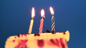 candle on a small birthday cake stockvideos u0026 filmmaterial 469777
