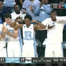 Invisible Cereal Meme - north carolina player celebrates on bench with delicious bowl of