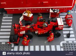 ferrari lego speed champions lego team crew members are fixing wheel of ferrari f14 t race car