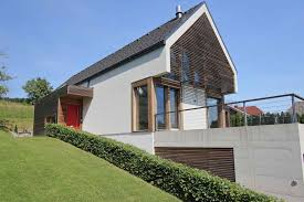 a combination a flat and gable roof modern glass houses kager