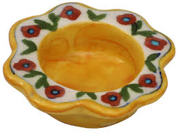 flower shaped yellow tea light candle holder in ceramic with