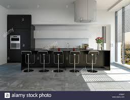 modern fitted kitchen with black bar counter and stools and built