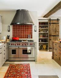 kitchens mediterranean kitchen with red rug also wood island and