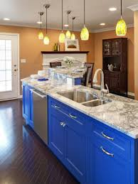 kitchen blue sainted wooden base wall cabinets island stainless