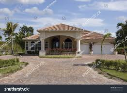mediterranean style home showing driveway main stock photo
