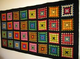 kimmy u0027s granny square crocheted bedcover and hand hooked rug