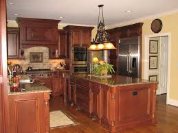 dark cherry kitchen cabinets wall color of cherry kitchen cabinets
