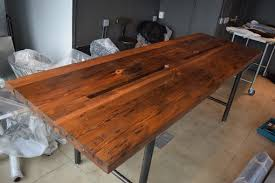 handmade reclaimed wood conference table with pipe legs by reworx