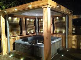 enclosed tub area complete with lighting privacy screens and