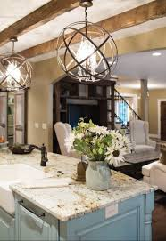 10 kitchen chandeliers to brighten up your kitchen modern these modern chandeliers with an innovative design contributed to add a modern touch to this classic living space placed above the kitchen island