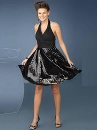 elegant liquid sequined knee length skirt halter neckline and open