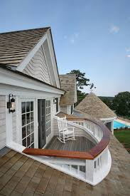 custom shinglework encloses this beautiful second story porch on