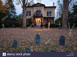 halloween decorations at dusk two story showcase home usa stock