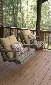 individual porch swings maybe facing each other on the front