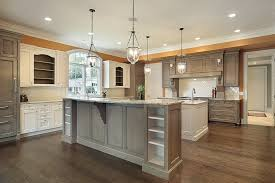 kitchens with two islands orange wall there two islands one grey other white dma homes