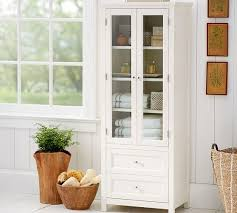 white linen cabinet with doors linen closet in white