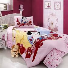 little bedroom with disney princess bedding and bold wall