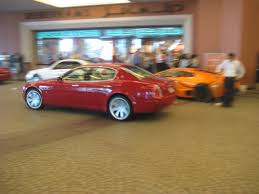 red maserati sedan red maserati quattroporte at mall of emirates 4 madwhips