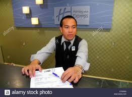 rhode island newport middletown holiday inn express motel hotel front desk lobby asian man employee clerk service uniform guest