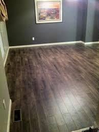 distressed luxury vinyl plank flooring in walkout basement lvp