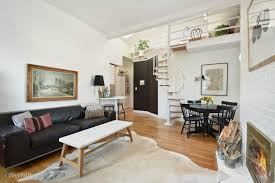 Cathedral Ceilings In Living Room by Hip Loft With Vaulted Ceilings And A Private Roof Deck Asks 485k
