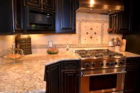 silver u0026 gold granite countertops with black cabinets travertine