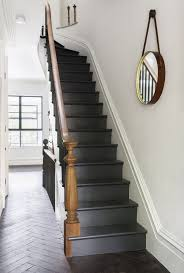 black staircase painted stairs painted stairway and wood brown banisters plus