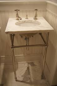 Small Powder Room Ideas Undermount Sink With A Marble Top On Console Legs Remodeled