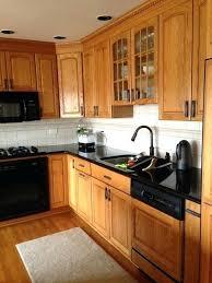 black handles on oak kitchen cabinets honey oak cabinets with black hardware kitchen inspiration
