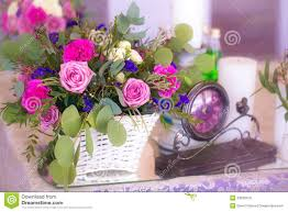 flower arrangement in a basket decorate the wedding table in pur