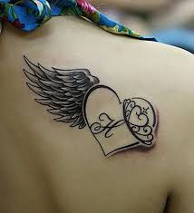 angel wing and heart with h letter tattoo on girls back