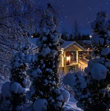 snowy christmas pictures illuminated house on snowy christmas evening stock photo colourbox